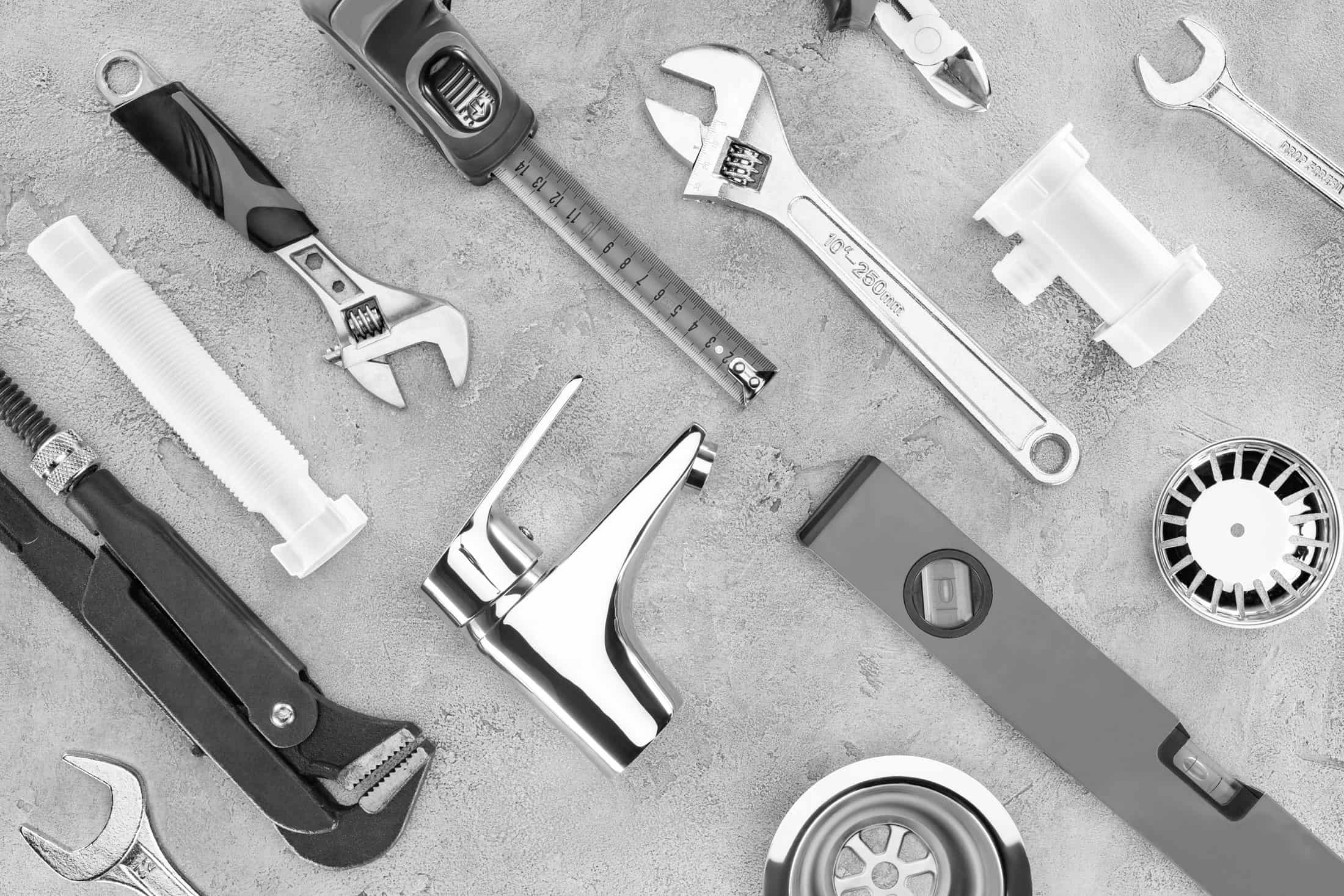 flat-lay-with-various-plumbing-tools-on-concrete-s-77LR4ZY